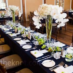 Navy, white with pops of bright green looks so fresh! cute white napkins and menus make it classy.
