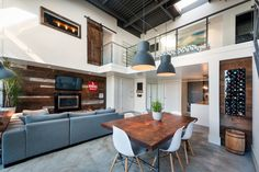 Vintage Modern Double-Height Loft in Vancouver Creatively Designed by TheMACNABS  Read more: http://freshome.com/2014/11/28/vintage-modern-double-height-loft-in-vancouver-creatively-designed-by-themacnabs/#ixzz3KNQwws3D