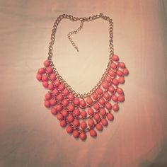 Gold and Coral New York & Company Necklace This is a gold and coral necklace from New York and company. It's a very bright, obvious piece that looks great with solid blouses. Also willing to trade. Jewelry Necklaces