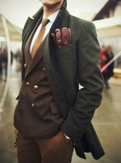 Men's Burgundy Leather Gloves, White Dress Shirt, Tobacco Knit Tie, Brown Double Breasted Blazer, Brown Dress Pants, and Olive Overcoat