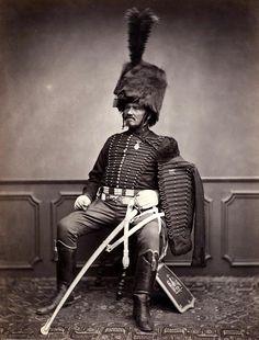 Waterloo veteran, Monsieur Moret, posing in grand hussar uniform.