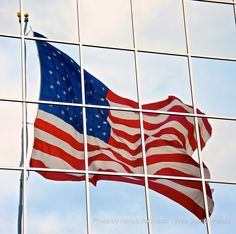 The American Flag in the window. Photo by Patrick Robinson #seattle