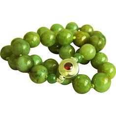 Anazing vintage large jadeite jade beads sterling garnet clasp from vintagebeautiful on Ruby Lane