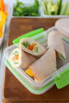 These super simple turkey wraps are the ultimate snack or light lunch when you're looking to make healthier choices!  Uses simple deli turkey, fresh sliced peppers and cucumbers and a wedge of Laughing Cow Cheese.  Just 3 Weight Watchers Smart Points!!