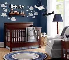 I like the idea of wooden cloud cut outs painted white upon a blue wall....