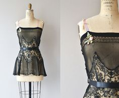 Rare 1920s black silk nightie with large lace panel making up the main bodice, floral embellishment across the top of the bustline, pink ribbon