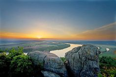 Panoramic view of the Arkansas River photographed from Petit Jean State Park, Morrilton, Arkansas. This park is named for a female French explorer who died here while the territory belonged to France. Her grave is still marked and is visited by many park goers. Photo © copyright by Tom Kennon.