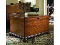 This attractive cocktail trunk provides a practical solution to storage. It features bun feet and a rich, high touch finish on special cherry veneers that provide an exceptional look and feel of a treasured antique.