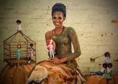 """Mwela Bryan international model and """"mother"""" of a new type of dolls - Malavill - showing here: Mwela wearing a HV Couture presenting Alexa, the African albino doll."""