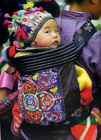 Miao in china The baby carrier in Asia protects the infant physically and symbolically. The choice of colors and design all have meaning, for example, a lotus is a symbol of long life.