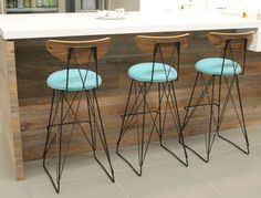 Eames inspired cats cradle bar stools made from bent wire frames with curved plywood backs. These barstools are built to order.
