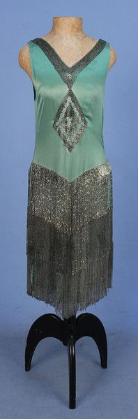 BEADED SATIN FLAPPER DRESS with FRINGE, 1920's. Sleeveless seafoam silk charmeuse with V-neck and back decorated with a band of crystal bugl...