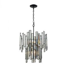 Elk Lighting Lineo 6 Light Chandelier In Matte Black With Clear CrystalThe Lineo series features brisk ? of resplendent beveled crystal that rise or flow in rhythm along a Matte Black laser-cut frame. Elk Lighting, Lighting Store, Home Lighting, Chandelier Shades, Chandelier Lighting, Chandelier Ideas, Metal Chandelier, Chandeliers, Laser Cut Metal