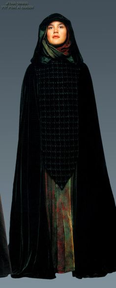 This forest green velvet cloak is worn by handmaidens of Padme Amidala in both Star Wars Episode I: The Phantom Menace, and in the senators funeral scene near the end of Star Wars Episode III: Revenge of the Sith.