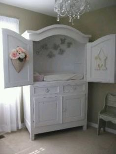 Tv Armoire upcycle to changing table with underneath storage.