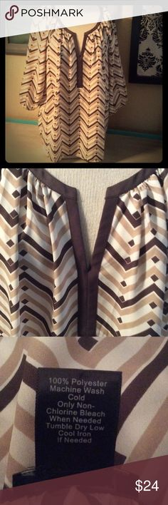 """Ann Taylor XL blouse This is a size XL 3/4 sleeve brown and white print Ann Taylor blouse with elastic sleeve cuffs. Great condition. It measures 50"""" bust and 16"""" from armpit to bottom seam. Receive a free gift when you spend $50 or more in my closet after offers and discounts and before shipping costs. Thank you for looking! Ann Taylor Tops Blouses"""
