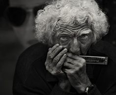 Harmonica Man by Andre du Plessis