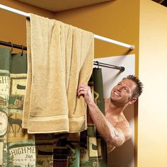 Hang two shower curtain rods. One on the inside for the shower curtain and one on the outside to create easy access to your towel when you're done in the shower. This guy sure seems happy about it.