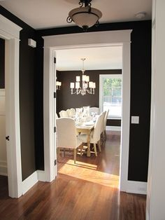 Love the wood trim And the wall colors is wonderful against the floor!! WOW!! <3 The black and white is an AMAZING contrast. I'm officially a fan of a stark contrast in wall and border colors.