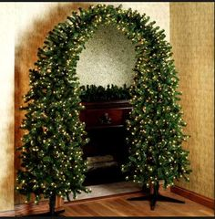 It's two trees bent together and attached at the top! This would be so cool for an archway! Christmas Tree Arch, Unique Christmas Trees, Upside Down Christmas Tree, Unique Christmas Decorations, Modern Christmas Decor, Beautiful Christmas, Noel Christmas, Christmas Wreaths, Decoration Noel
