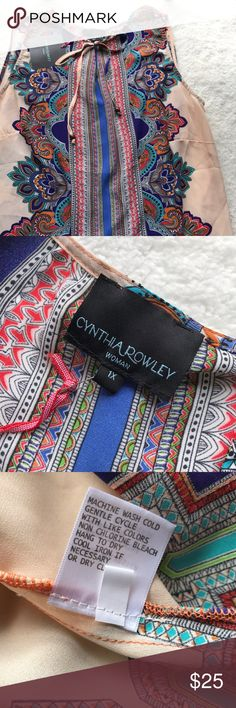 NWT Cynthia Rowley Plus Sleeveless Top NWT Cynthia Rowley Plus Sleeveless Top has a fun colorful paisley pattern.   100% polyester Machine Wash Cold Cynthia Rowley Tops