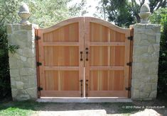 Here is a photo of the entry gate from the back, which shows some of the hardware I use. This design was inspired by another Spanish driveway gate that I ...