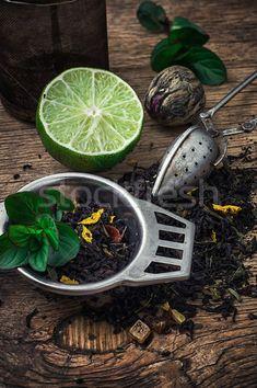 tea brew with lime and mint on wooden background  stock photo (c) nikolaydonetsk (#5510921) | Stockfresh