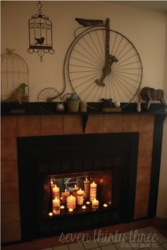 Candles in Fireplace! I love fireplaces and am blessed to once again have two very lovely victorian ones in my house t which I love putting candles in for a bit of warmth & relaxation coupled with a smoking cauldron of resin incence : ) bliss