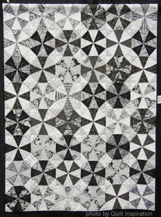 Kaleidoscope quilt  in black and white by Dawn Guglielmino, quilted by Beth Hummel, 2014 Road to California.  Photo by Quilt Inspiration