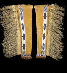 A pair of Eastern Apache beaded leggings Very finely tanned, a band of beading runs the length of the ochre-dyed leg, darker dye and fringe about the cuff area, pale green pigments, twisted hide thongs and heavy fringe along the side flaps. length 34in   RUUQQ - 6/4/07