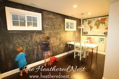 What a great idea! Create a whole wall of chalkboard for your kids!