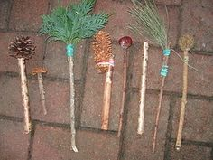 Home-made 'Autumn' paint brushes.  I made these out of all the things we had found and collected when out on our walks and simply hot glued or attached them to sticks with elastic bands.