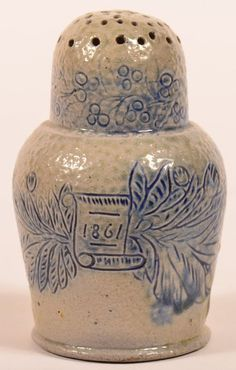 "Sold $40,000 Very Fine and Rare, Probably One of a Kind, F.H. Cowden, Harrisburg, PA Stoneware Sgrafitto and Blue Slip Decorated Dome Top Pepperpot Dated 1861. Having cornucopia, floral, foliate, berry and scroll incised decoration washed in blue slip and salt glazed. Incised in base ""F.H. Cowden, Hr. (Harrisburg), Oct. 1861"". Frederick H. Cowden was the son of John Wallace Cowden, founder of the Cowden Potteries in Harrisburg, Pennsylvania in 1861."