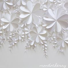 White 3d paper blossom artworks. Measuring in at a large 125cm x 75cm, this piece showcases the simplicity and purity of white on white. We love the play of the shadows on the folded hearts as the light changes, although these same shadows make it a very difficult artwork to create as they play tricks on our eyes, creating gaps, filling other ones, and confusing us completely!