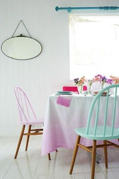 White floor boards and paint dipped chairs.