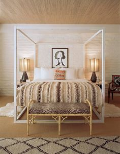 Love the combination of an ultra-modern bed and ethnic bedding. Take a look at www.bringingitallbackhome.co.uk for a similar Moroccan blanket. www.naturalbedcompany.co.uk make the Orchid four-poster - a similar bed design....