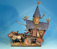 a wonderful caravan, designed to look very much part of the Warhammer world.