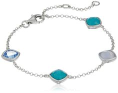 Sterling Silver Lab-created Blue Quartz, Lace Agate and Reconstituted Turquoise Cushion Cut Station Bracelet. Hand-finished bracelet crafted in pure .925 Sterling Silver.