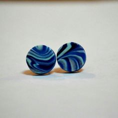 These beautiful handmade marbled earrings in varying shades of blue are truly one of a kind. They are so fun but can still be dressed up!