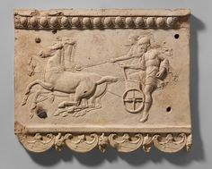 Terracotta plaque with King Oinomaos and his charioteer