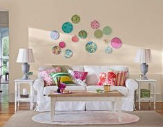 cute idea for a playroom/ bonus room. The circles should be larger and have some depth variation though. Maybe covering the back of a ceiling medallion (to add some depth), or a foam form...