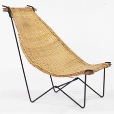 1950S  lounge chair  USA rattan, iron 30 w x 36 d x 38 h inches Removable sling cane seat on wrought iron base.