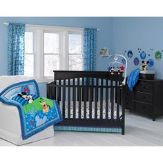 """Give your little mouse a best friend at bedtime. The Mickey Mouse Best Friends 3-piece crib bedding set includes a comforter featuring Mickey Mouse and Pluto with a detailed mix of prints in stripes, stars and circles, accented with an appliqué """"M"""" for Mickey, plus a fitted crib sheet and a dust ruffle, all in bold blues and greens with a pop of red."""