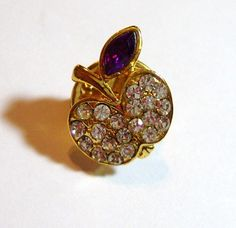 no makers name on this vintage rhinestone apple tie tack or you could use it as a brooch pin    a tad less than 6/10 of an inch in height x a tad more