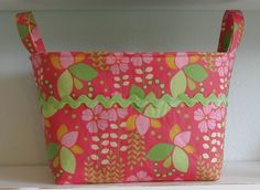 "FABRIC BIN- Flowers- Bright Coral Pink- Lime Green- Yellow- REVERSIBLE- Large    This fabric basket is made from two different colorful prints. The outside print has fabulous colors of flowers in pinks, greens and yellows. Giant lime green ""rick rack""  Be sure to see our creative home decor items at www.CreativeHomeDecorations.com lime green, flower"