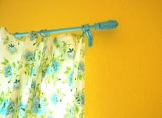 I love what a little aqua spray paint can do to a boring black curtain rod!