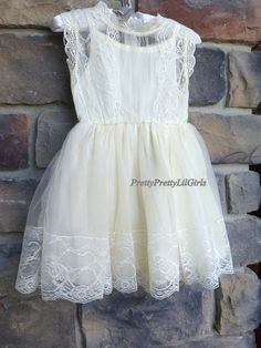 Sweet as Can Be Light Ivory Girls Lace Dress Girls Ivory Dress with a Darling Lace Pattern with a Multi layered tulle lined skirt ... This is a One Piece dress..its look separate but, it is one piece