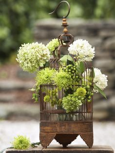 Flight Of Fancy: With its crosshatched wires, a birdcage makes an ideal display for top-heavy foliage, like these hydrangeas and hypericum berries. Find your own vintage aviary at a flea market or tag sale, remove its perch (but keep the rust), and pop a small vase inside. Then randomly slip a variety of blooms between the bars.