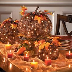 Create a gorgeous pumpkin patch on your Thanksgiving table with these pre-lit grapevine pumpkins. You can also place them individually by the fireplace or group them together and sit them on the porch.