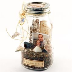 Make a memory jar with sand, stones, shells, photos and tickets